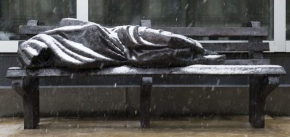 Sculpture-of-Homeless-Jesus-Sleeping-on-Bench-is-Rejected-by-Churches